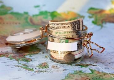 small-money-jar-on-world-map-800x600.jpg