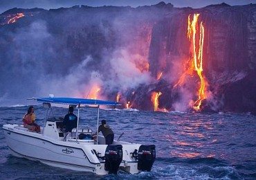 Couple watch magma from boat