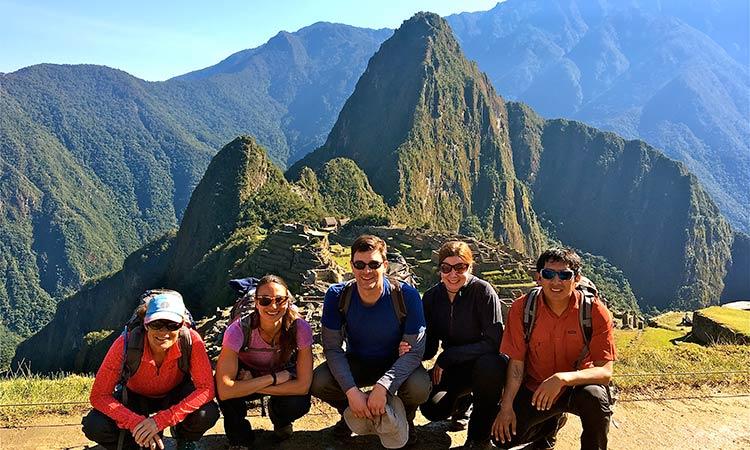 Group celebrating at Machu Picchu