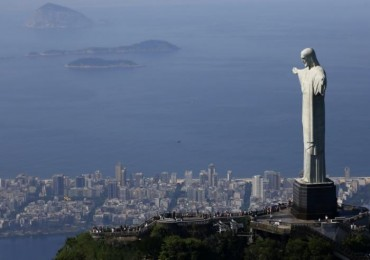 Tourists visit the Christ the Redeemer statue in Rio de Janeiro