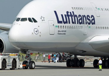 BERLIN - JUNE 08:  A groundcrew member helps guide Lufthansa Airbus A380 passenger plane before take off at the ILA Berlin Air Show on June 8, 2010 in Berlin, Germany. The 2010 ILA will run from June 8-13.  (Photo by Sean Gallup/Getty Images)