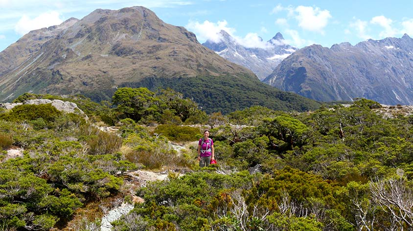 Female hiker on the Routeburn Track guided walk