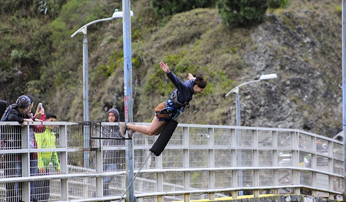 Heather bungy jumping off a bridge