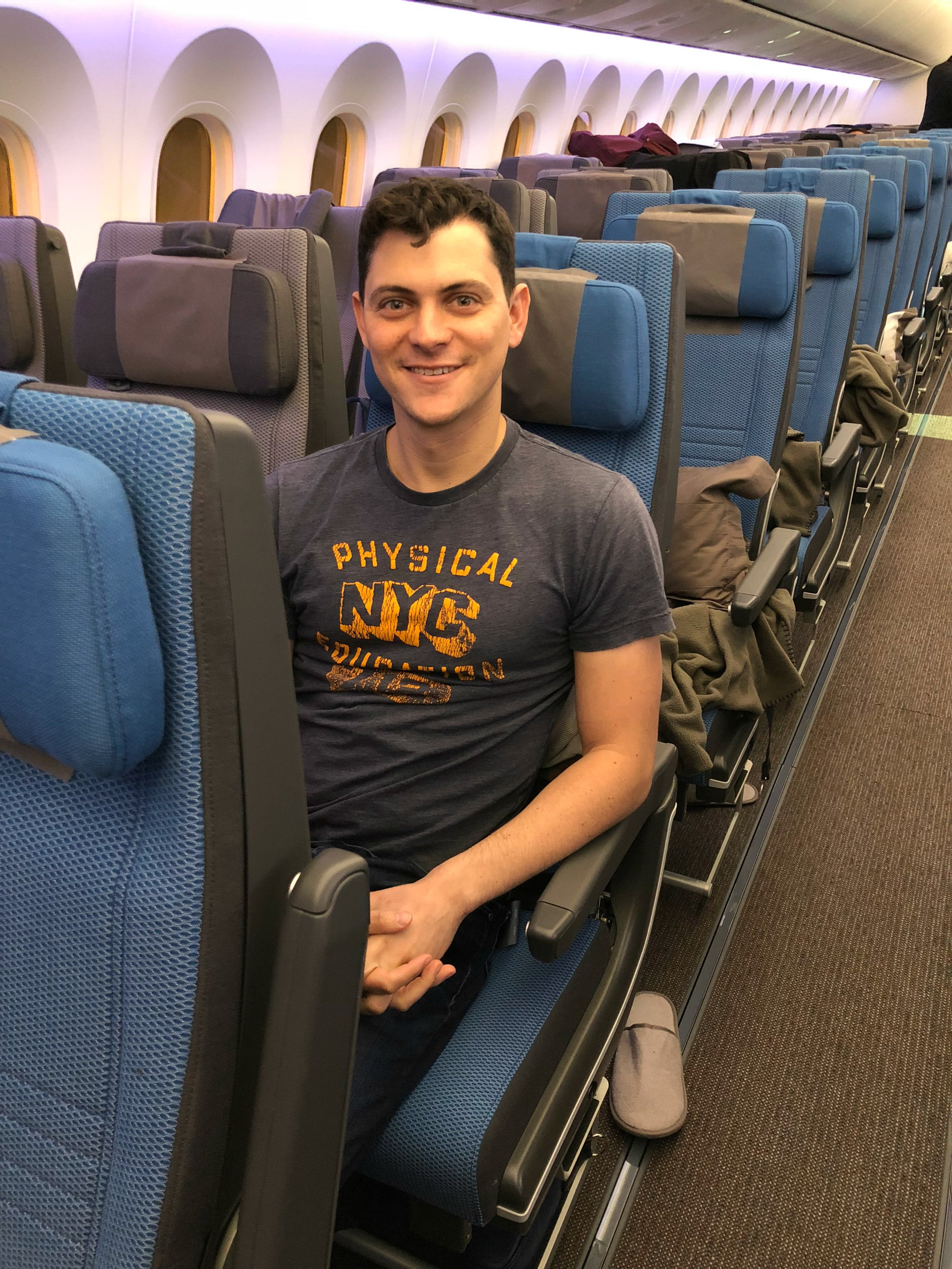 Matt Kepnes sitting in economy class on Singapore Airlines' new Dreamliner