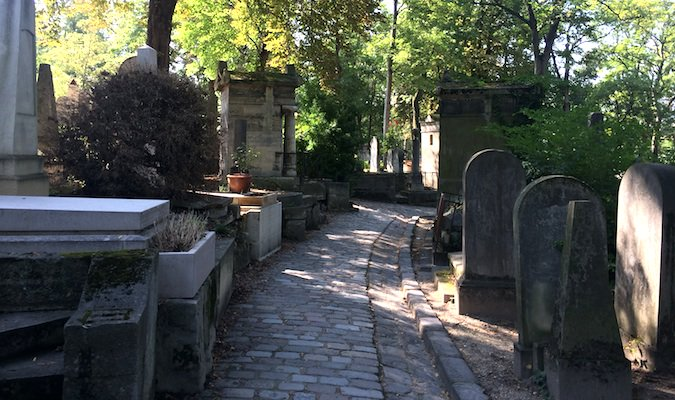 Beautiful haunting pathway through French graveyard