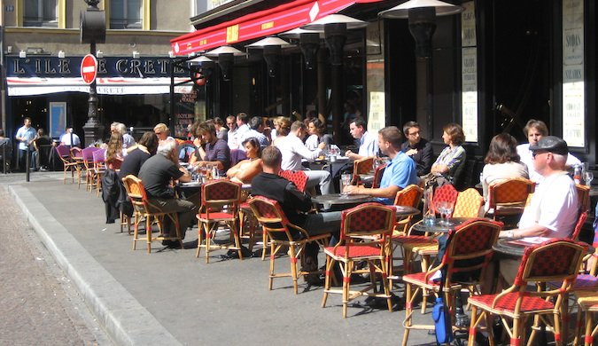 People dining at a street cafe in Paris France